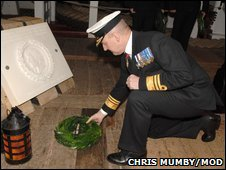Vice Admiral Richard Ibbotson laying a wreath