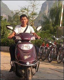 Wan Li on electric scooter in Guilin
