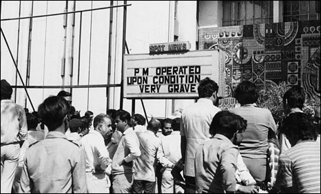 A news ticker in Delhi announcing Mrs Gandhi's condition in hospital