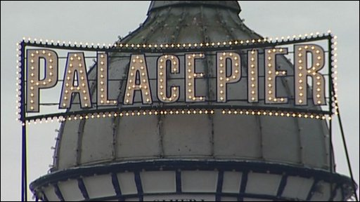 A sign 'Palace Pier' placed by film-makers on Brighton Pier.