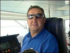 Colin McArthur piloting the catamaran