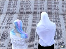 Bosnian Muslim survivors of the Srebrenica massacre search for names of their relatives (file image)