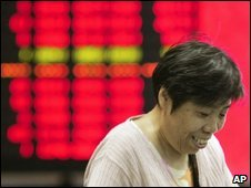 An investor in front of stock prices monitoring board in Shanghai - 21 September 2009