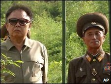 North Korean leader Kim Jong-il with military officer - photo released 11 October 2009