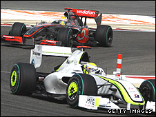 Jenson Button's Brawn leads Lewis Hamilton's McLaren at the Bahrain Grand Prix