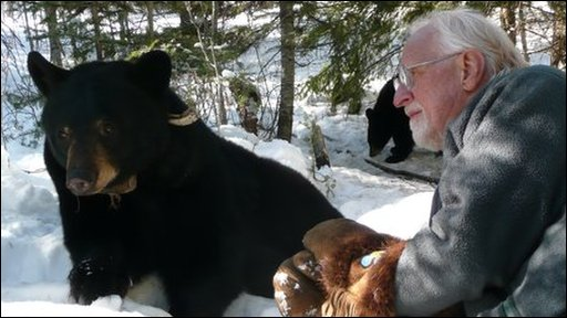 "Lynn Rogers and black bear ""June"""