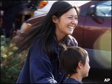 Falcon Heene, 6, front, is guided back to a news conference by his mother, Mayumi (file image)
