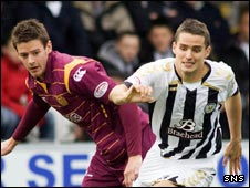Lucas Jutkiewicz (left) challenges St Mirren ace Lee Mair
