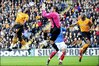 Portsmouth's keeper David James claims the ball