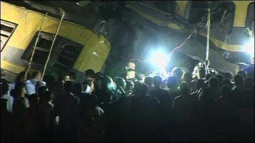 Crowds gather at the scene of the crash in the Egyptian capital Cairo