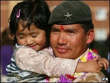 Ltn Corp Ajay Tamang recieves a welcome home hug from his daughter Sneha