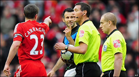 Jamie Carragher (left) and Ryan Giggs remonstrate with the referee