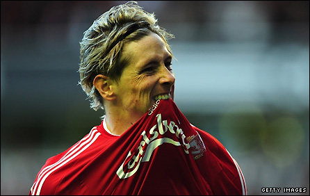 Fernando Torres celebrates scoring against Liverpool