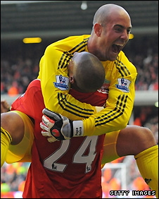 Pepe Reina celebrates with goalscorer David Ngog