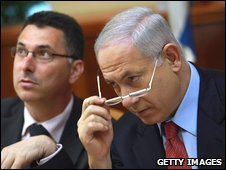 Israeli Prime Minister Benjamin Netanyahu looks over his glasses next to Education Minister Gidon Saar at the start of the weekly cabinet meeting 18 October 2009