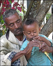 Hailemariam Workneh plays with his son while his wife is treated for fistula