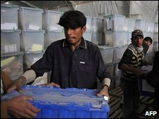 Afghan employees from the Independent Election Commission (IEC) load ballot boxes into a truck to be sent to provinces, in Kabul on October 22, 2009