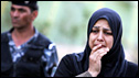 An Iraqi woman reacts to the aftermath of the bombings in Baghdad (26 October 2009)