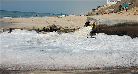 Outflow of partially treated sewage on beach south of Gaza City