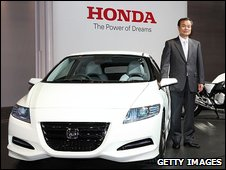 Honda president Takanobu Ito with the new concept car CR-Z at the 41st Tokyo Motor Show in September 2009