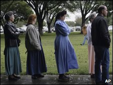 Potential jurors queue outside the Texas courtroom