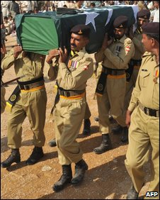 Pakistani soldiers carry the coffin of a comrade killed in South Waziristan