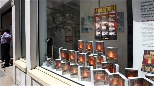 L Ron Hubbard's books on display in the window of the French Scientology headquarters