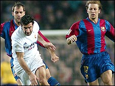 Gaizka Mendieta (right) tracks Real Madrid's Luis Figo