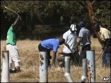 Members of the Zanu-PF militia beat unidentified people at the venue of the proposed Movement for Democratic Change (MDC) party rally in Harare, Sunday, 22 June 2008