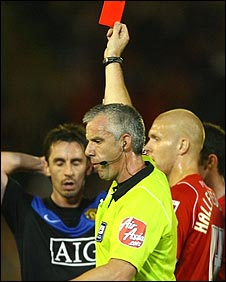 Gary Neville is sent off by referee Chris Foy