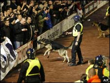 Riot police and dogs guard fans at Barnsley v Man Utd game
