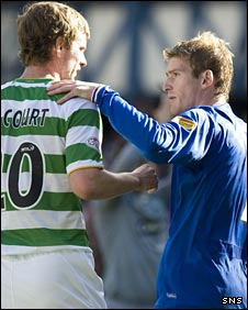 Celtic's Paddy McCourt and Rangers' Steven Davis embrace
