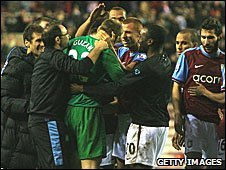 Guzan is mobbed by his Villa team-mates