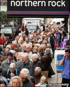 Northern Rock customers wait to withdraw savings in  2007