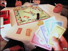 People playing monopoly
