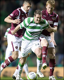 Celtic striker Chris Killen barges through the Hearts defence