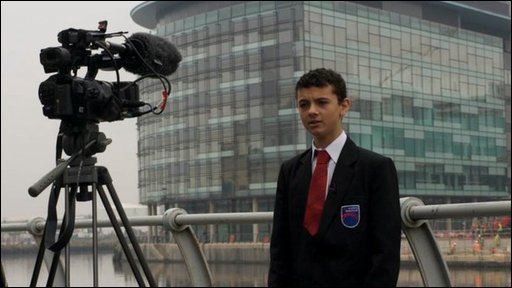School Reporter Abdou from Oasis Academy being filmed by the BBC's Steve Rawling in front of MediaCityUK