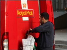 A postman opening his van