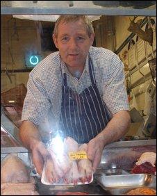 Mark Aldridge holding pigs trotters