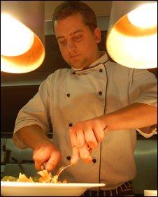 Josh Colman cutting into dish