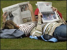 couple reading the papers