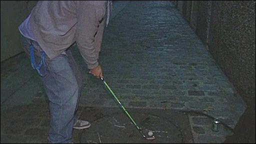 Teeing up in a game of street golf