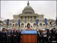 Nancy Pelosi speaking on the steps of the Capitol