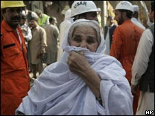 A grief-stricken woman visits the site of Wednesday's bombing in Peshawar a day later looking for her missing son