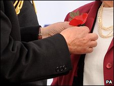 Pinning a poppy on Dame Vera Lynn