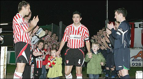 Derry City's long-serving captain Peter Hutton was applauded on to the pitch
