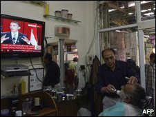 Palestianians watch Mr Obama's Cairo speech from a barber shop in the old city of Arab east Jerusalem  (file image)