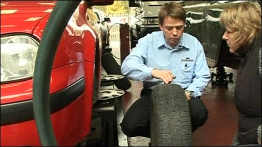 Car tyre being checked