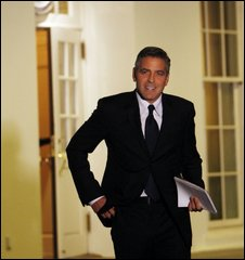 Actor George Clooney walks out of the West Wing of the White House in February 2009