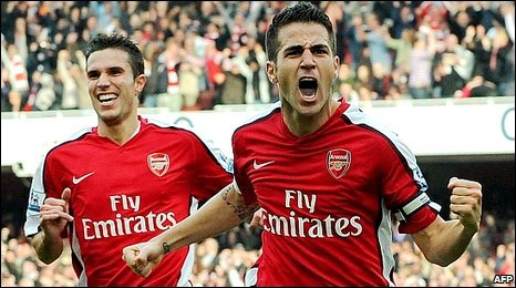 Cesc Fabregas (right) and Robin van Persie celebrate
